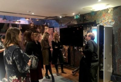 A male employee demonstrates the functions of LG Styler to visitors of LG UK's Styler launch event