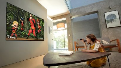 A young girl watches Disney's 'The Incredibles' in her living room via the outstanding picture quality of the ultra-thin LG OLED TV GX