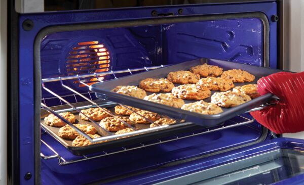 A tray of cookies is being taken from the LG Oven, with baking made easy via its LG ProBake Convection®