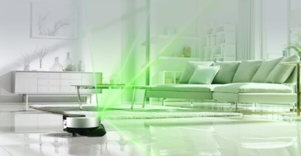A promotional image of LG CordZeroThinQ beaming green light over the living room as it scans the room.