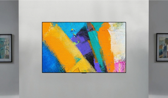 The front shot of the LG GX Gallery TV displaying colorful abstract art
