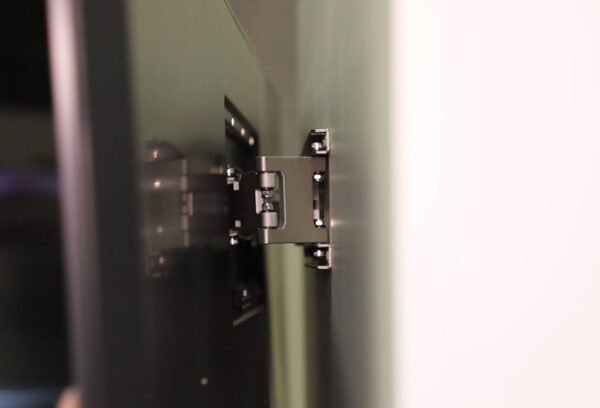 A close-up shot of the integrated bracket which holds the LG GX Gallery series TV against the wall