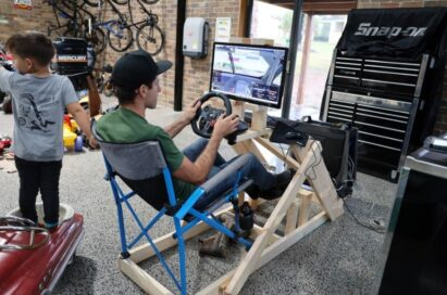 Rick Kelly, a supercar racer, experiencing his beloved sport online with his homemade racing simulator