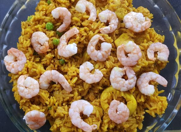 A close-up of the shrimp Paella being prepared