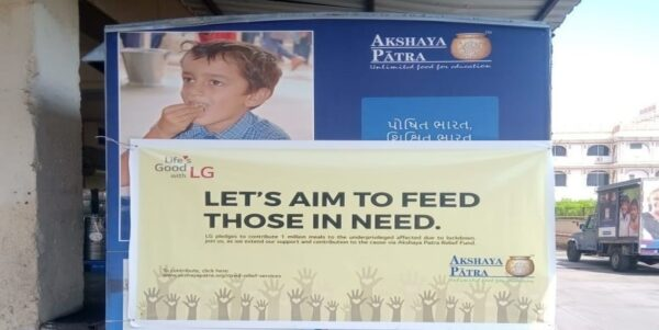 "The front shot of a banner reading ""Let's Aim to Feed those in Need"""