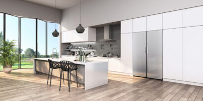 A whole view of a modern kitchen featuring LG Fridge and Freezer pair