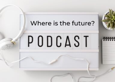 "Promotional image of LG's ""¿Dónde queda el futuro?"" podcast with its English translation, 'Where is the future?', displayed in between a notepad and some headphones"
