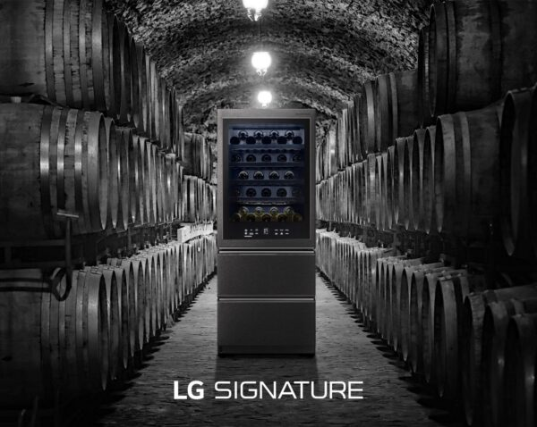 LG SIGNATURE Wine Cellar standing in the middle of a more traditional wine cellar full of wine barrels