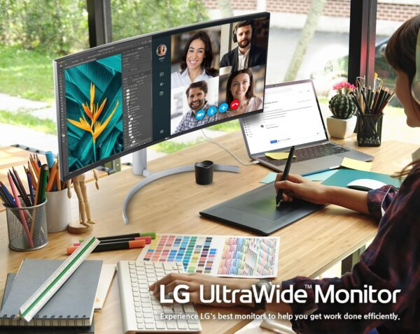 Someone using split tabs on LG's new UltraWide monitor in their home office to talk on a video call and work on a drawing at the same time