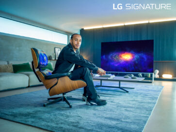 World Champion Lewis Hamilton, who has been appointed as a global ambassador for LG SIGNATURE, sitting in front of LG OLED TV as he poses for the camera