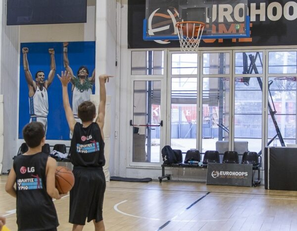 Children shooting the basketball during the LG Athletes of Tomorrow program