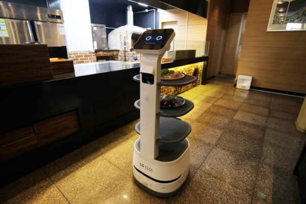 LG CLOi ServeBot being prepared to deliver meals to guests by the restaurant's kitchen