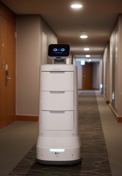 LG CLOi ServeBot carrying out room service by delivering supplies around the building