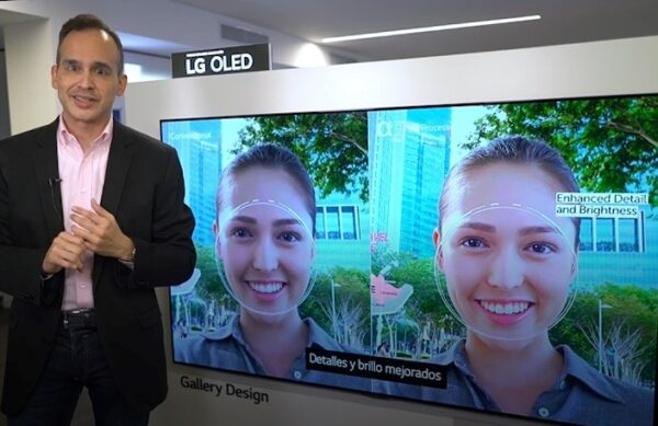 Luis Gálvez of LG stands in front of a newly launched LG OLED TV as he talks about its enhanced detail and brightness