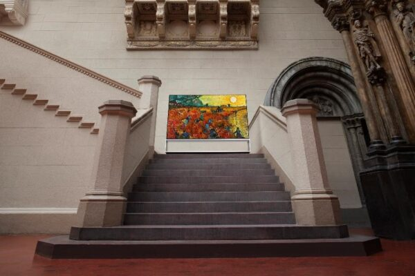 ​ LG SIGNATURE OLED 8K TV stands on the stairway of the Pushkin State Museum of Fine Arts in Moscow, Russia, while displaying one of its famous paintings