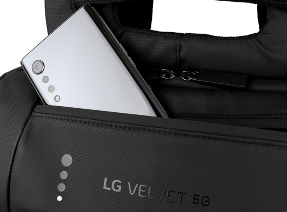 A close-up of the waterproof backpack designed by George Sully with LG VELVET completing the look in its pocket.