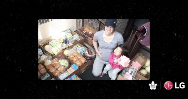 Local hero Janelle Jong and her daughter posing with food that has been donated to help feed hungry people in their community.