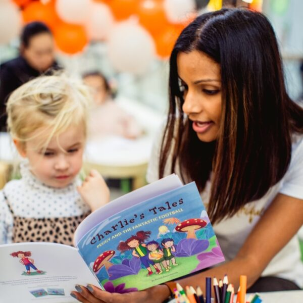 Merissa Forsyth, founder of the Pretty Foundation that encourages girls to feel better about their bodies, reading a book to a young girl.