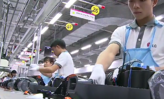 LG's Vietnamese employees assembling electronic appliances inside the company's Haiphong Campus.