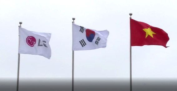 The three flags of LG, Korea and Vietnam hoisted above the LG Haiphong Campus