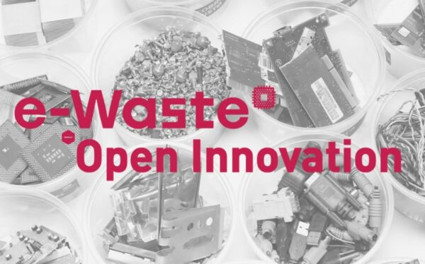 Mechanical parts that have been disassembled from electronic devices with the title 'e-Waste Open Innovation'