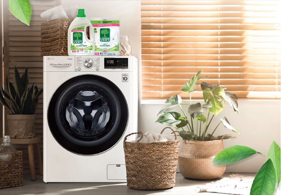 LG Washer with L'Arbre Vert's detergent and fabric softener on top and green plants on both sides