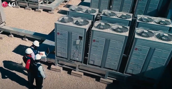A screenshot from the LG HVAC Solutions YouTube video showing three men examining a building's LG Outdoor Units.