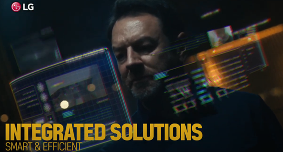 A screenshot from the LG HVAC Solutions YouTube video representing smart and efficient integrated solutions with a man working on a holographic display