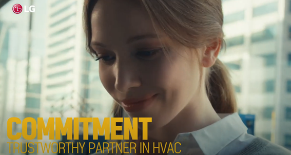 A screenshot from the LG HVAC Solutions YouTube video representing commitment with a woman looking down and smiling
