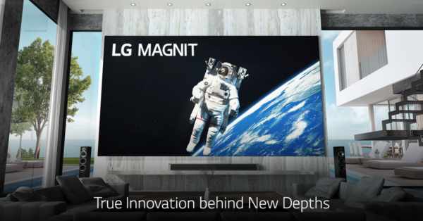 LG MAGNIT hanging on the wall of a modern living room as it displays an astronaut floating in space
