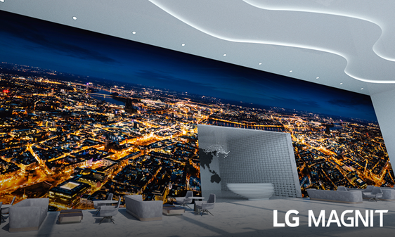 LG MAGNIT installed in a spacious building lobby and displaying an urban landscape at night