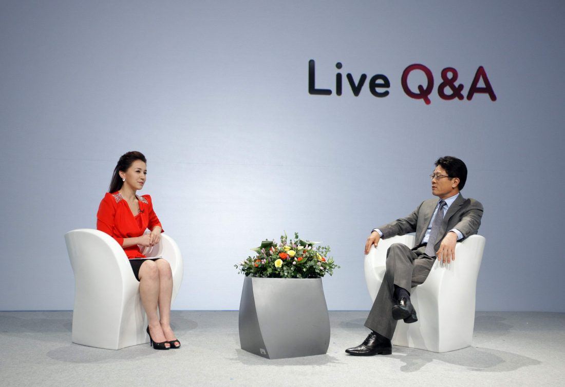 Dr. Skott Ahn answers questions from the host on the LG Optimus stage.