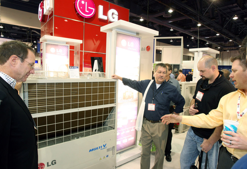 Visitors to LG's booth look inside one of LG's Multi V air solutions.