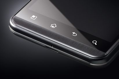 A bottom-side view of the LG Optimus 3D with black in the background