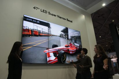 A woman showcasing the 47-inch LED Super Narrow Bezel Display to visitors at ISE 2011