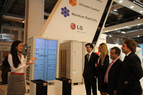 A woman explaining LG MULTI V III products to a group of people