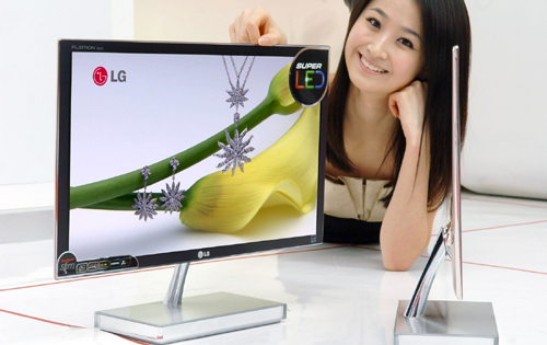 A model posing with two LCD LED Monitor model E90s on the floor