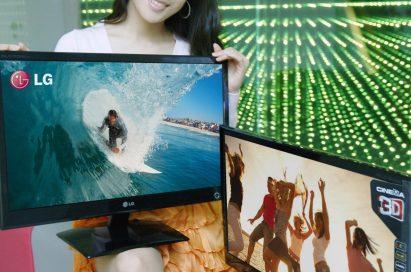 A model wearing 3D glasses is presenting two LG Cinema 3D Monitors