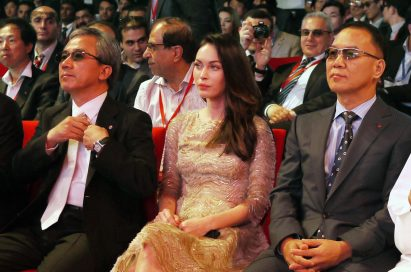 Kyung-hoon Byun, executive vice president of LG Electronics Home Entertainment Company, Megan Fox and K.W. Kim, president of LG Electronics, Middle East and Africa, sit together at Ferrari World in Abu Dhabi