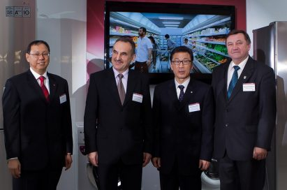 A group of LG executives poses to celebrate on the launch of LG's Home Appliance production facility in Poland.