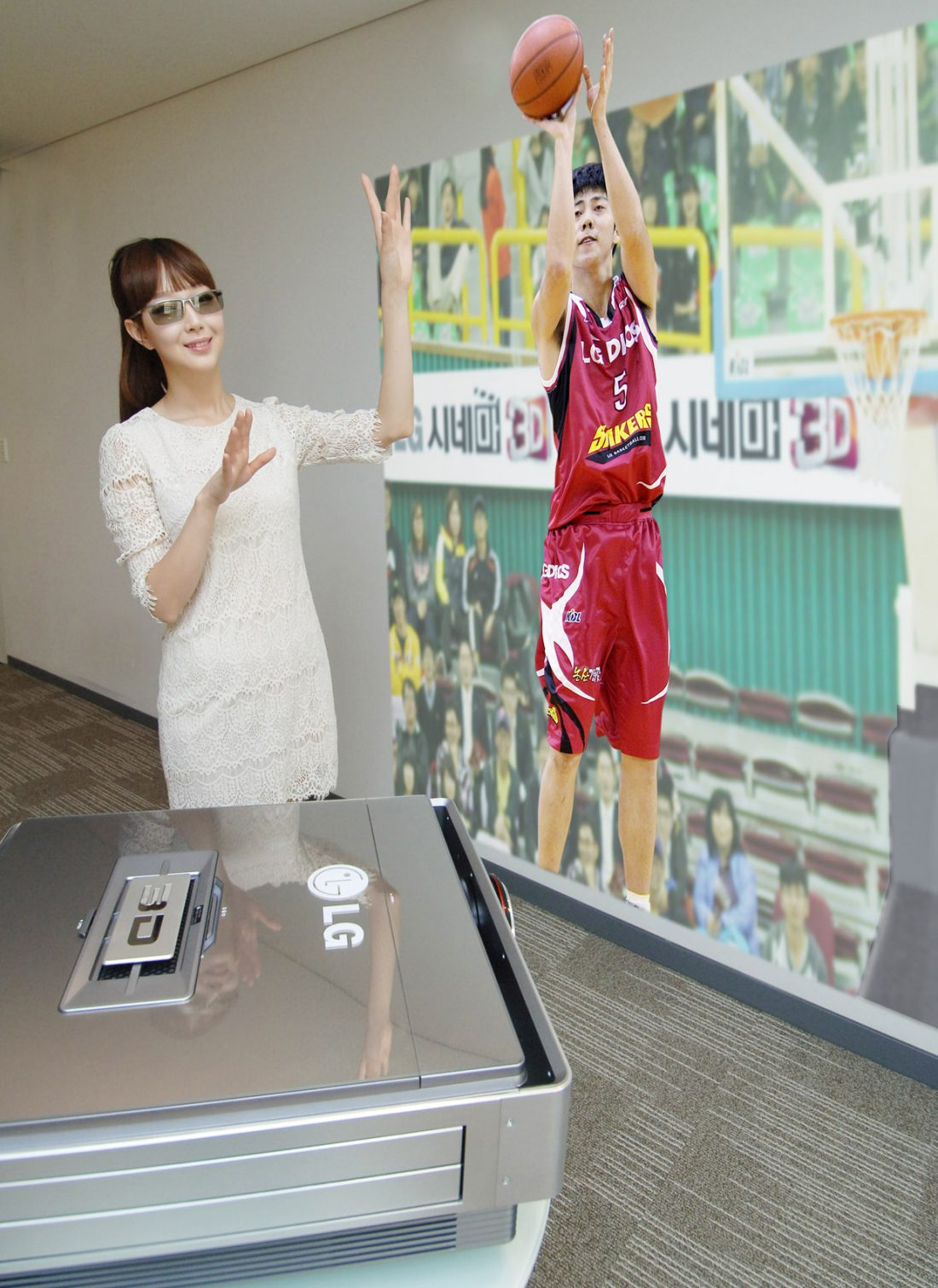A model wearing 3D glasses while experiencing the CF3DAT CINEMA 3D projector, which is projecting a basketball player taking a shot