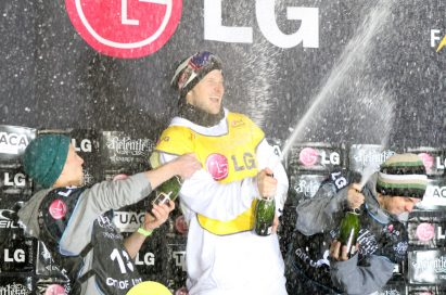 The players celebrate their winning with champagne in front of the LG stand