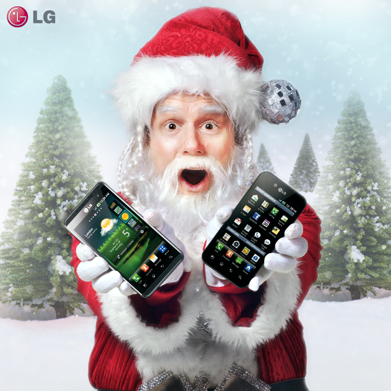 Santa Claus holds LG Optimus 3D and LG Optimus Black and shows its front views