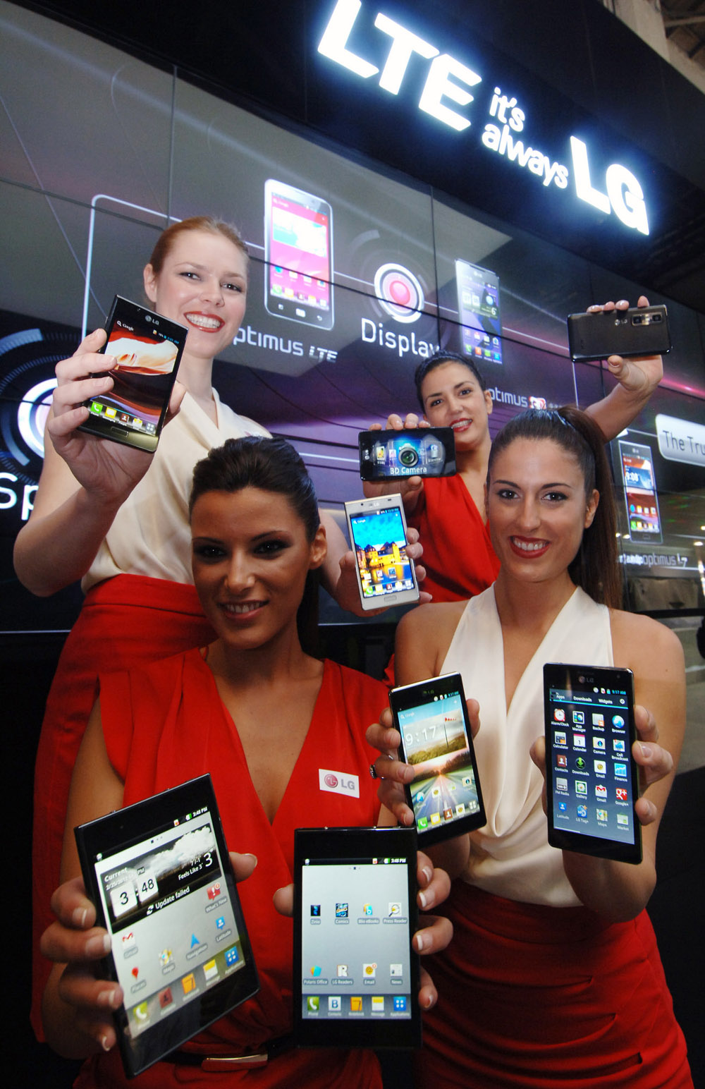 Another image of four female models holding eight LG LTE smartphones at MWC 2012