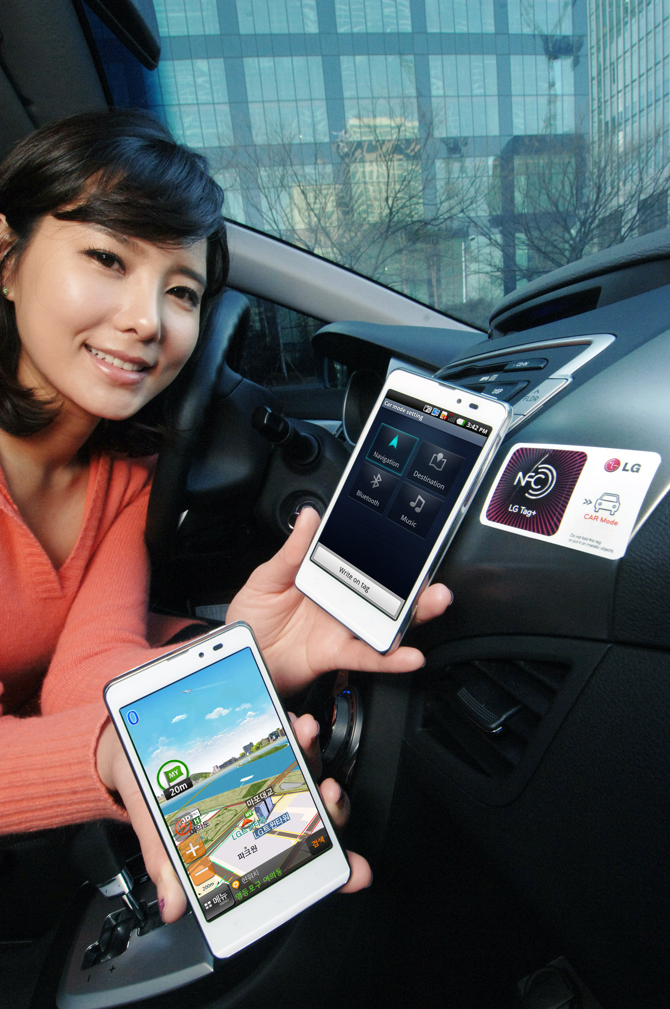 A female model holds two LG Optimus LTE Tags and shows their front views inside a car