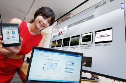 A model introduces the LG Cloud service which is compatible with TVs, mobile devices and PCs while standing up