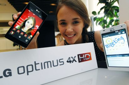 A model holds a black and white versions of LG Optimus 4X HD behind the logo of LG Optimus 4X HD