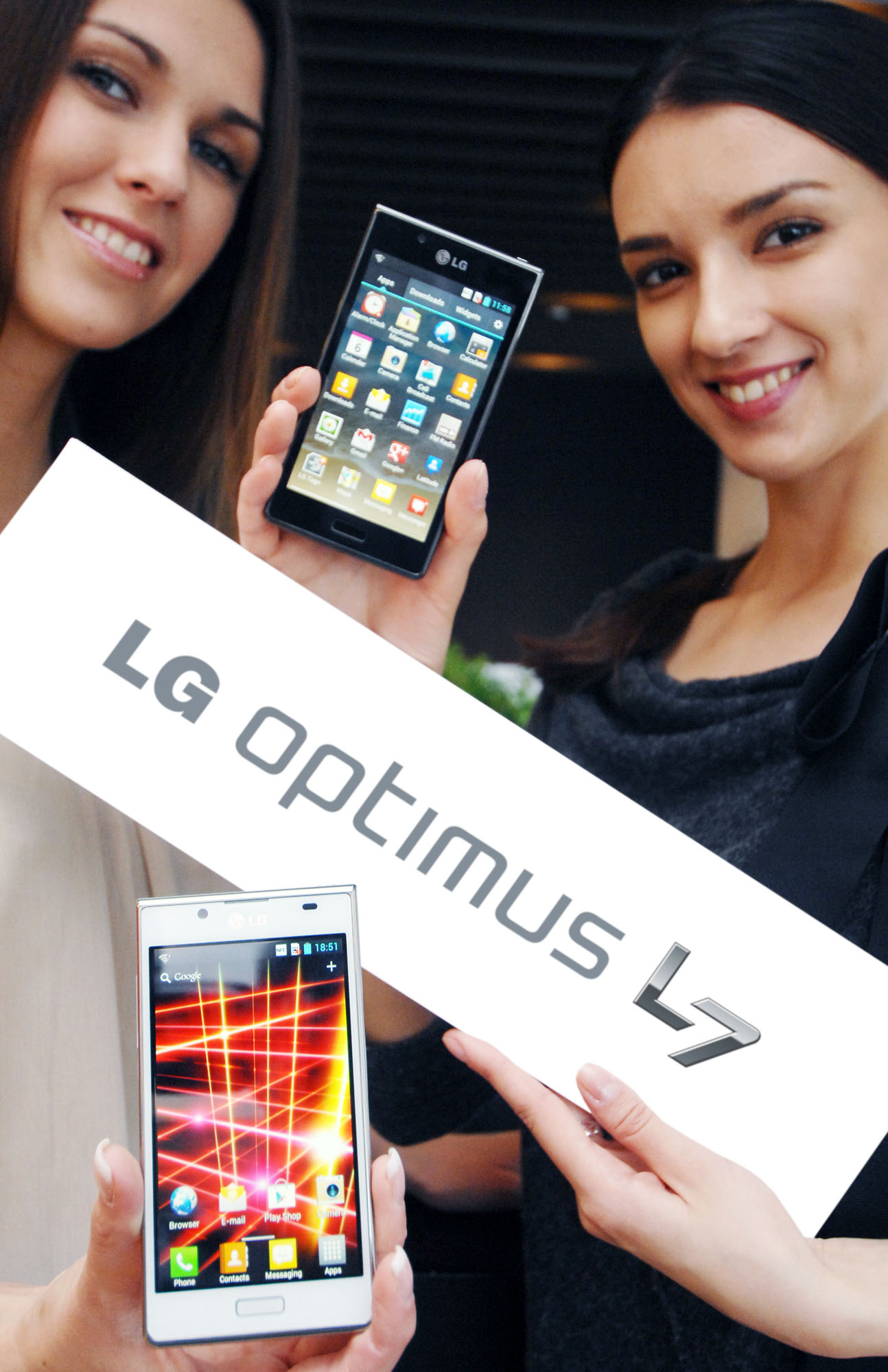 Another view of a model holding the white LG Optimus L7 while another holds the LG Optimus L7 and the LG Optimus L7 logo