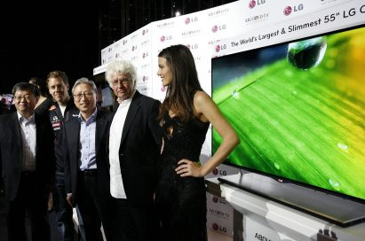 From left to right: LG's vice president of Overseas TV Sales and Marketing Ki-il Kwon, F1 Champion Sebastian Vettel, LG Europe Head Stanley Cho, film director Jean-Jacques Annaud and model Gemma Sanderson pose in front of LG's 55-inch OLED TV in Monaco