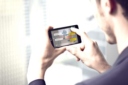 A man is touching a screen of LG Optimus G